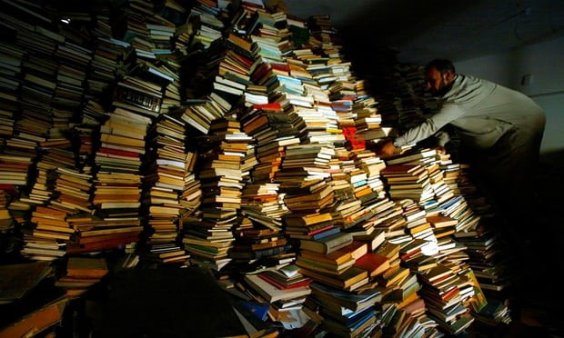Iraqi assistant Imam Sheikh Mahmood Hachim sifts through thousands of books from the Iraq National Library, stored in Baghdad's Imam Alhaq Ali mosque in 2003. The books were looted after the fall of the capital, with some returned when clerics spoke out. Photograph: Saurabh Das/AP